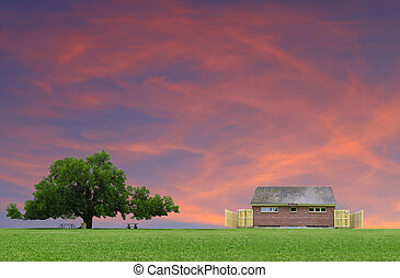 A large oak tree in a grass field in a park used as a shade tree for picnic tables along with a public restroom on a gorgeous summer day with clouds and a gorgeous glowing sunsetting sky with room for