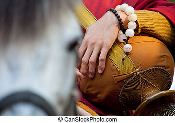 buddhist monk Riding horse