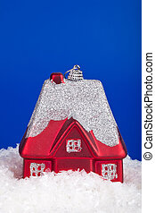 Christmas toy in the form of a small house on a blue background