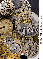 Time Pieces in a pile partly disasembled
