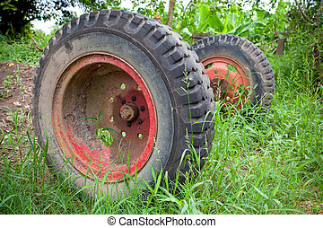 Old used car tires in the green nature