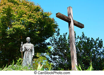Priest and Cross Statue - Statue of a priest facing a cross