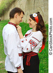 Ukrainian people - Slav girl with wreath and young cossack...