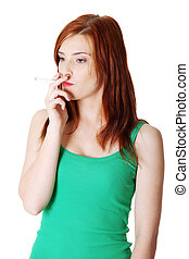 Teen smoking girl - Pretty standing teen caucasian smoking...