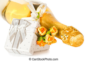 Champagne bottle, present box with bow and flower...