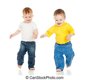 Two little boys playing game and running