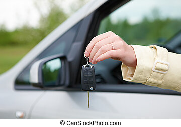Hand with car keys - Hand showing keys out the car window