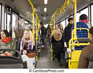People in a bus - Large group of People going by bus