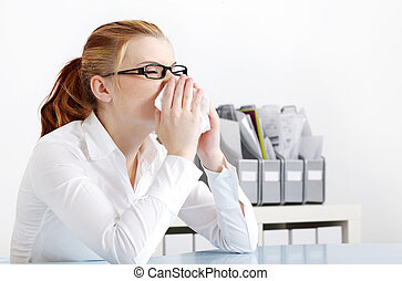 Sneezing woman in the office.