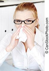 Sneezing woman`s closeup.
