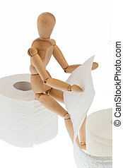 wooden figure on a roll toilet paper - a wooden figure and a...