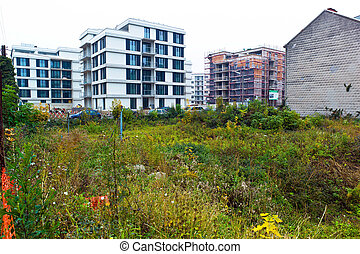 vacant lot between two houses