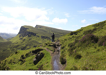 Man hiking on the isle of Skye in Scotland - Man hiking in...