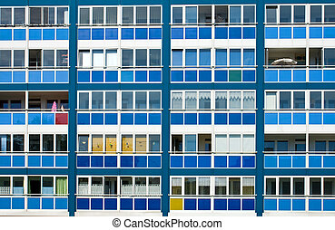 Blue facade of an GDR apartment building seen in Berlin