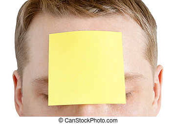 Man with a blank adhesive note on the forehead - Portrait of...