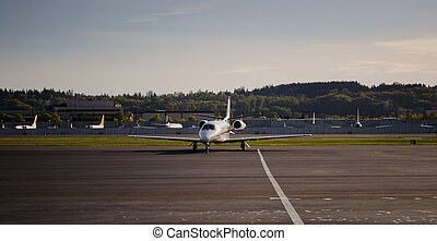 Corporate Jet Arriving at Ramp - Mid-size business jet...