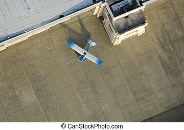 Single Plane Outside of Executive Hangar - Overhead aerial...