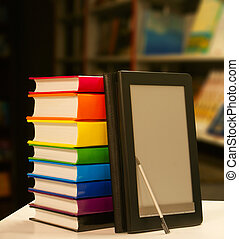 Stack of books with electronic book reader