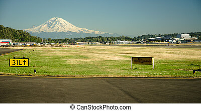 Mount Rainier and Boeing Field - Mt Rainier towers above...