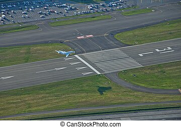 Corporate Jet Landing from Aerial View - A corporate jet on...