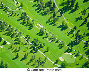 Aerial Golfing During Late Afternoon - Aerial view of a golf...