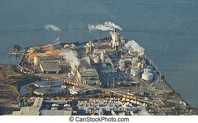 Paper Mill on Peninsula - Aerial - Smokestacks from a paper...