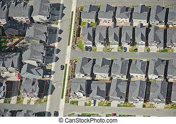Single Car Driving Out of Housing Complex - Aerial view of...