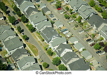 House Rows Aerial - Three rows of houses in a new suburban...