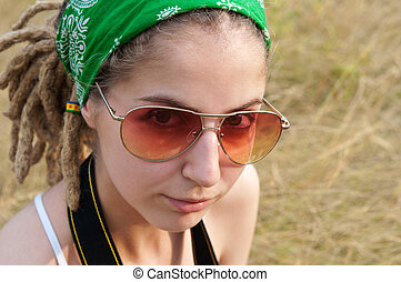 beautiful young hippie girl - young hippie woman in a green...