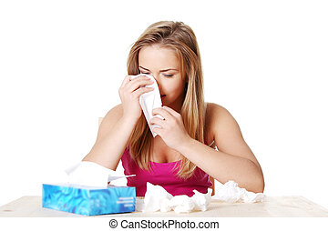 Attractive young woman using a tissue.