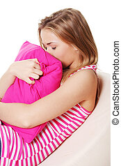 Depression - Teen girl in depression hugging pink pillow