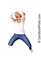 Young happy caucasian woman jumping in the air with thumbs...