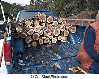 Loading Firewood - A pick-up truck stacked with firewood in...