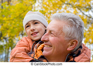 grandparent and kid - portrait of a grandfather with child...