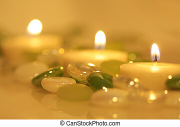 Lit candles surrounded by glass beads