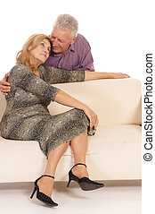 cute old couple at couch - cute old couple posing at couch...