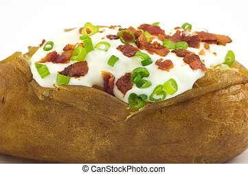 Baked potato with toppings - Baked russet potato with sour...