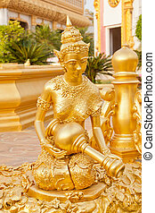 Golden buddhist statue in Wat Phra Mahathat Chedi...