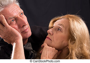 old couple on black - cute old man and woman posing on black