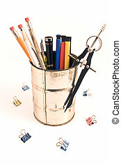 Pencils and pens in a tin holder