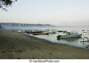Island of Nusa Lembogan on morning - Beach and boats on the...