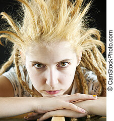 strange hairdo - young girl with a strange hairdo on a black...