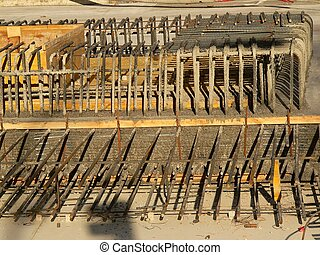 steel rods making up the base of a building on a construction site