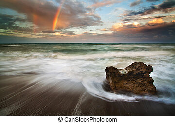 Rainbow Rock - Rainbow over the ocean with waves and rock