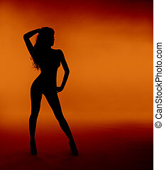 woman sexy silhouette over orange background - woman sexy...