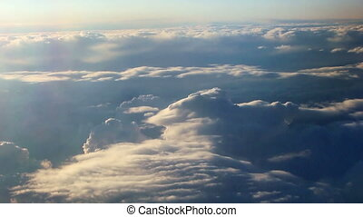 Aerial view of clouds over landscape from airplane