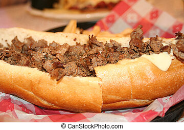 Philly Cheesesteak - Closeup of a sliced Philly cheesesteak.
