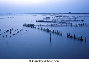 blue sunset at sea - beautiful sunset in Taiwan at a Oyster...