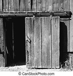 OPEN SLIDING BARN DOOR - A sliding barn door stands open