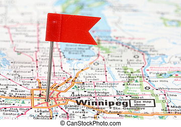 Winnipeg in Manitoba, Canada Red flag pin on an old map...
